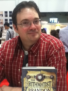 "Brandon Sanderson, the hilarious author of Alcatraz vs. the Evil Librarians! (Which I loved. And reviewed. Forever ago, but still!) He was signing copies of his first novel for teens, ""The Rithmatist."""